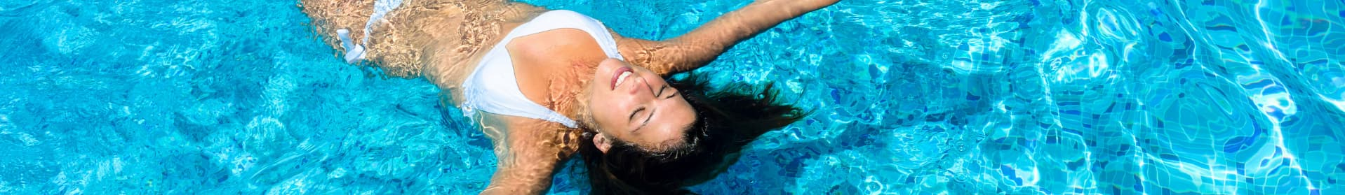 Woman Floating In Maintained & Serviced Commercial Pool